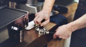 Barista Working with Coffee Machine