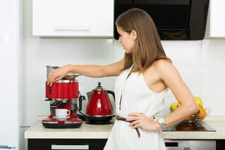Making coffee at home with coffee machine